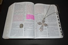 Bible with cross and gardian angle royalty free stock photography
