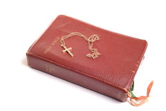 Bible and crucifix. Photograph of a bible and crucifix,shot in studio against a white background Stock Photography