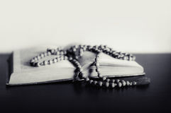 Bible and the crucifix on a table. Royalty Free Stock Photography