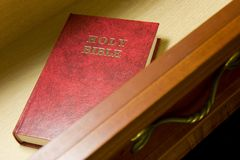 Bible in drawer. Holy Bible in hotel guest room bedside table drawer royalty free stock photos
