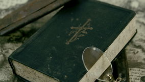 The bible eyeglass and the razor on the map stock footage