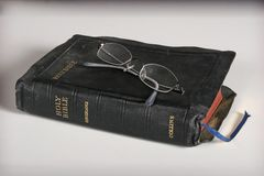 Bible and eyeglasses Stock Image