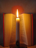 Bible and faith (2). Open Bible with a light candle Royalty Free Stock Images