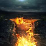 Bible and fire. A large Bible as a bridge over large flames royalty free stock photos