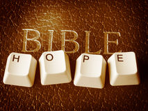 Bible gives hope. In the computer age Stock Photo