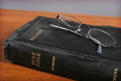 Bible and Glasses Stock Photos