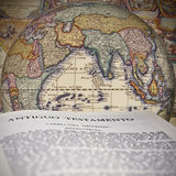 The Bible on the globe stock illustration