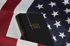 Bible and Gold Cross on American USA  Flag Stock Image