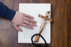 Bible, hand and cross Stock Images