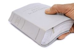 Bible with hand Stock Images