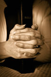 Bible and Hands Stock Images