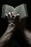 Bible and hands Stock Image