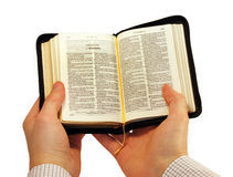 Bible in Hands. Stock Photos