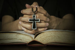 Bible and hands holding a rosary Royalty Free Stock Photos