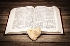 Bible and day in love. A Bible and happy valentine`s day in love royalty free stock photos