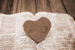 Bible and day in love. A Bible and happy valentine`s day in love royalty free stock photography