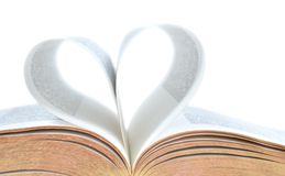 Bible with heart shape on pages. Close crop of a bible with pages making a heart Royalty Free Stock Images