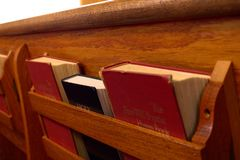 Bible and Hymnal in Pew stock image