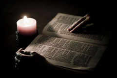 Bible illuminated by candle Royalty Free Stock Images
