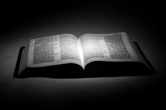 Bible illuminated in the Dark Stock Images