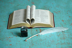 Bible Inkwell and Feather Stock Images