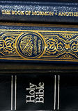 Bible and Koran (Qur'an) and Book of Mormon. Side by side Royalty Free Stock Photos