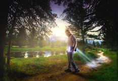 Bible leaving a trail of light. A man carries a Bible that leaves a long trail of light Royalty Free Stock Photos
