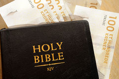 BIBLE AND MONEY Stock Photo