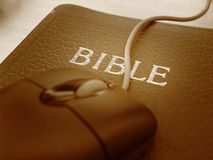 Bible and mouse - close up Stock Photo