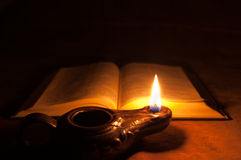 Bible and Oil Lamp. Close-up of an oil lamp and Bible Stock Images