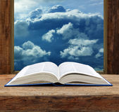 Bible open book  wooden window sky view. Stormy cloud Stock Image