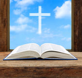 Bible open christian cross light sky view. Window wooden Royalty Free Stock Photography