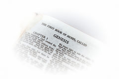 Bible open to genesis vignette. Holy bible open to the first book of moses called genesis, with white vignette giving the image a clean heavenly feel Stock Images