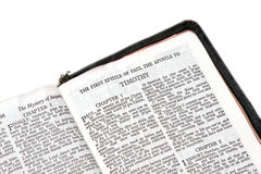 Bible open to timothy. Holy bible open to the first epistle of paul the apostle to timothy, on white Stock Image
