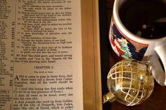Bible, Ornament, and Christmas Coffee. Bible, Ornament, and Christmas Coffee Mug on a table top Royalty Free Stock Photos