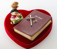 Bible over red velvet heart. Anniversary concept Royalty Free Stock Image