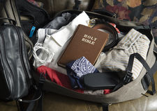 Bible in packed mans suitcase Royalty Free Stock Photos