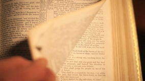 Bible page turn stock footage