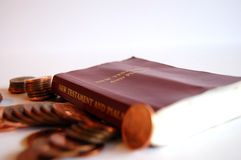 Bible and pennies Stock Image