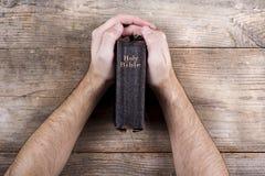 Bible and praying hands Royalty Free Stock Photos