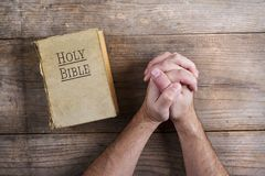 Bible and praying hands Royalty Free Stock Photo