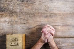 Bible and praying hands Stock Image