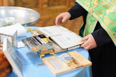 Bible in Priest's Hands Royalty Free Stock Photos