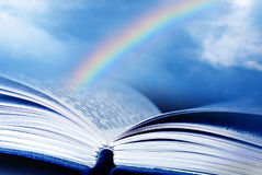 Bible with rainbow. Bible and rainbow with the background of blue sky royalty free stock photo