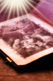 Bible with rays of light. Old bible in pink tonality with rays of light royalty free stock images