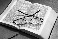Bible Reading. Black and White image of a Bible open and reading glasses. Simple, uncluttered and to the point Royalty Free Stock Photography