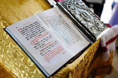 Bible on reading-desk or lectern, sacred lectern in the church decorated with golden friezes and ornaments.  royalty free stock images