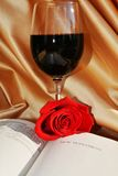 Bible, red wine and rose on luxurious background Royalty Free Stock Images
