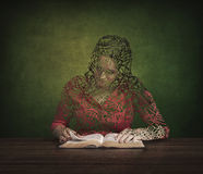 Bible and restoration. A woman is restored by reading her Bible Royalty Free Stock Photography