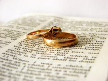 Bible and rings Stock Photos